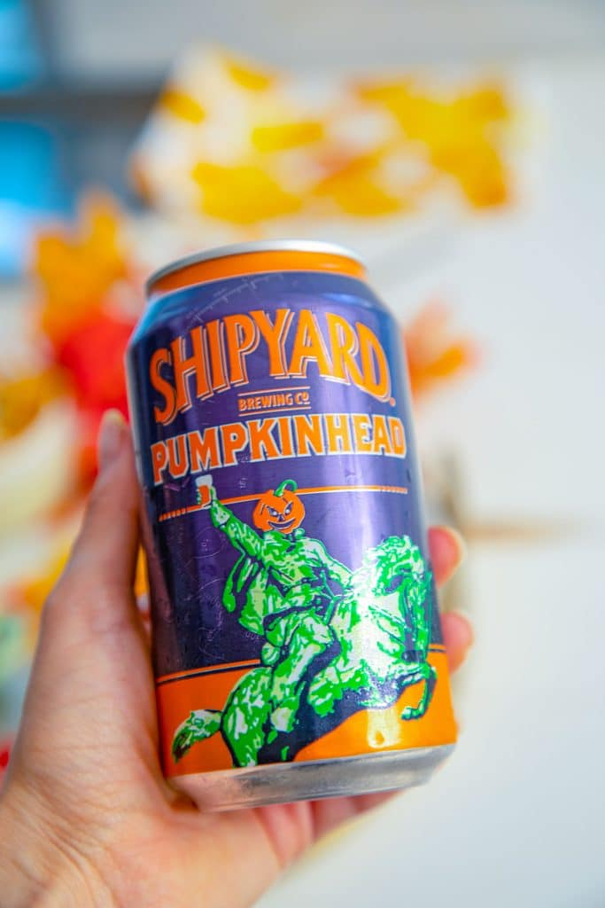 Hand holding can of Shipyard Pumpkinhead beer