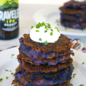 Purple Mashed Potato Pancakes with Garlic and Pancetta -- Mashed potato pancakes need no improvements, but they're way more fun when made with purple potatoes, garlic, pancetta, and cheddar cheese. These Purple Mashed Potato Pancakes with Garlic and Pancetta should be served at every cocktail party | wearenotmartha.com