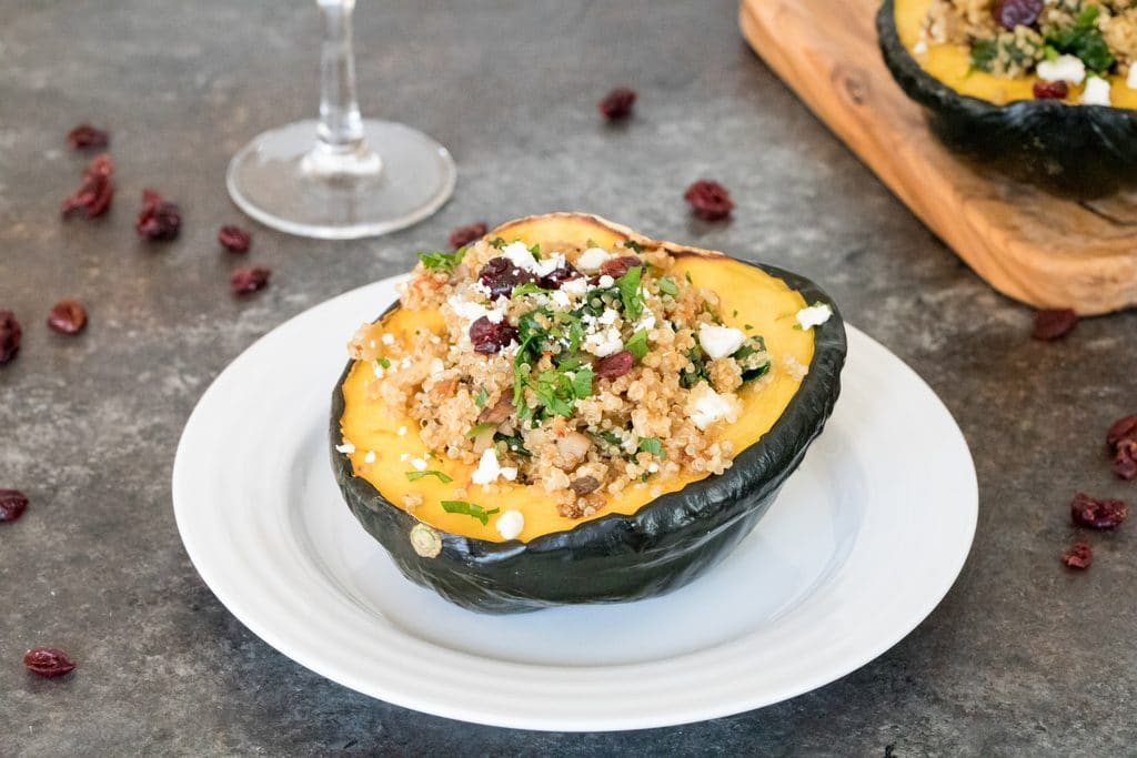Quinoa-Stuffed Acorn Squash -- The perfect healthy dinner for the holiday season and beyond. Tender acorn squash with a delicious quinoa and mushroom filling topped with feta cheese is filling and incredibly satisfying | wearenotmartha.com
