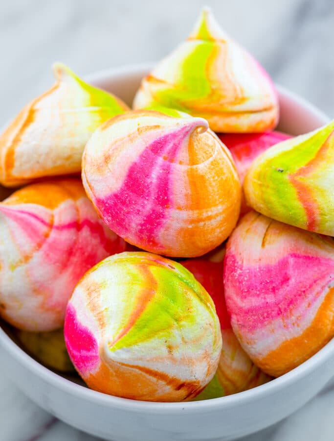Rainbow Sherbet Meringues -- These Rainbow Sherbet Meringues are packed with orange, lime, and raspberry flavors and taste just like a bowl of rainbow sherbet... Except they won't melt!   wearenotmartha.com