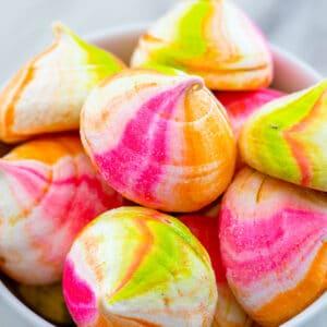 Closeup view of rainbow sherbet meringues in a bowl