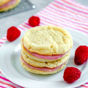 Raspberry Cream Sandwich Cookies -- These Raspberry Sandwich Cookies are made up of delicate vanilla sugar cookies and a delightful fresh raspberry and white chocolate filling | wearenotmartha.com