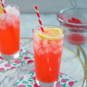 Raspberry Vodka Lemonade -- Made with fresh raspberries, lemon juice, and simple syrup, this Raspberry Vodka Lemonade will be your new favorite refreshing summer cocktail | wearenotmartha.com