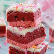 Red Velvet Cookie Dough Bars -- Perfect for showing your love this Valentine's Day, these treats are composed of a pink cookie crust, a luscious layer of chocolate chip red velvet cookie dough, and a white chocolate ganache topping | wearenotmartha.com
