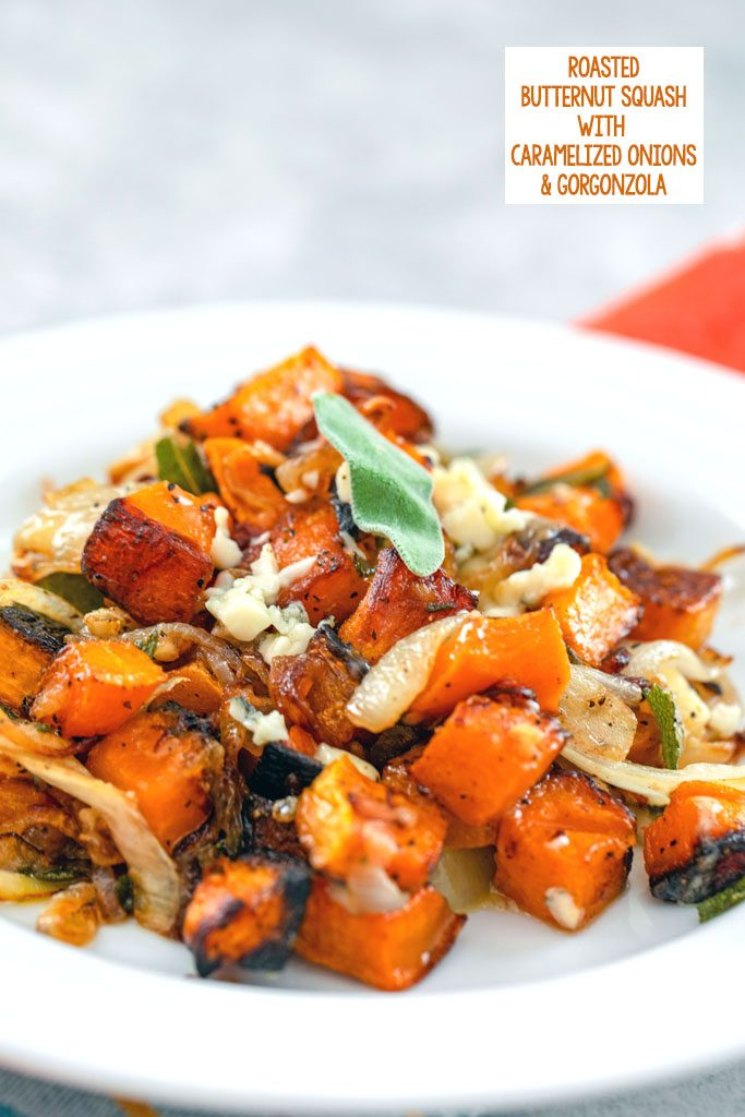 Head-on view of roasted butternut squash with caramelized onions and gorgonzola with crispy sage on a white plate with recipe title at top