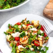 Roasted Cauliflower BLT Salad -- This Roasted Cauliflower BLT Salad uses kale instead of lettuce and also includes avocado and a creamy lemon dressing... It's enough to turn anyone into a cauliflower fan! | wearenotmartha.com