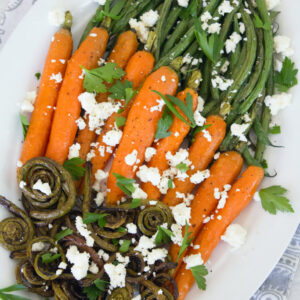 Roasted Fiddleheads, Carrots, Haricot Vert -- A vegetable side dish topped with feta | wearenotmartha.comRoasted Fiddleheads, Carrots, Haricot Vert -- A vegetable side dish topped with feta | wearenotmartha.com