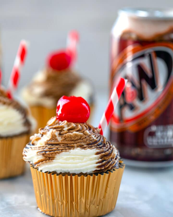 Root Beer Float Cupcakes -- Soda craving? These Root Beer Float Cupcakes topped with a whipped cream frosting and root beer syrup (and a cherry, obviously) will totally hit the spot | wearenotmartha.com