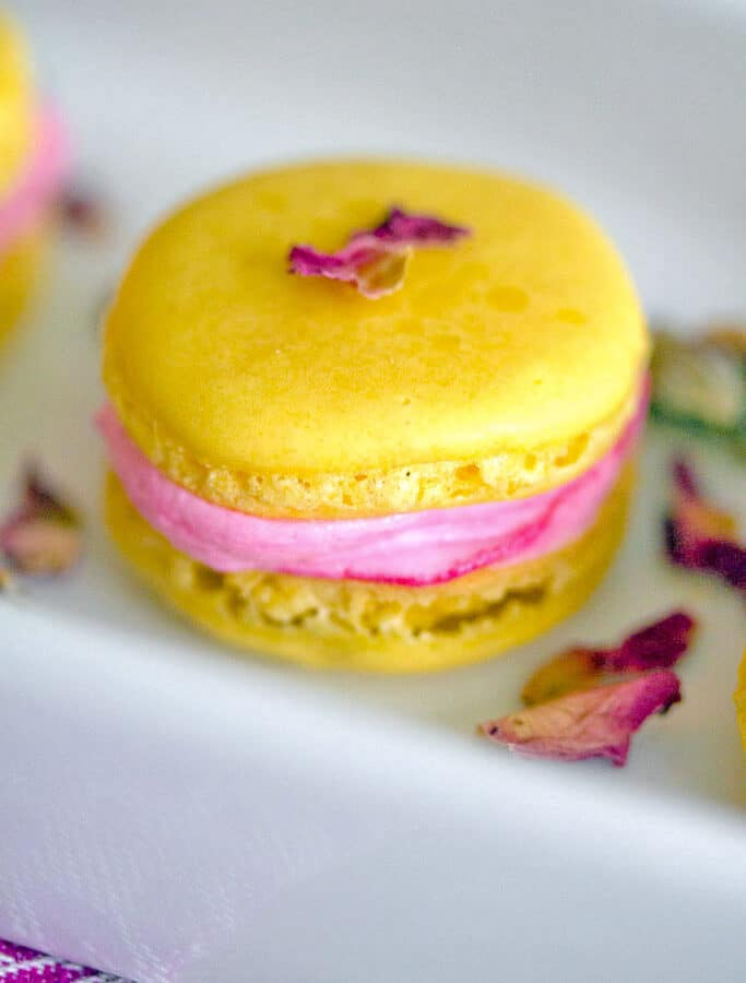Summer in macaron form? These Rose Lemonade Macarons have a light and refreshing lemon flavor and are combined with a deliciously bright rose buttercream.