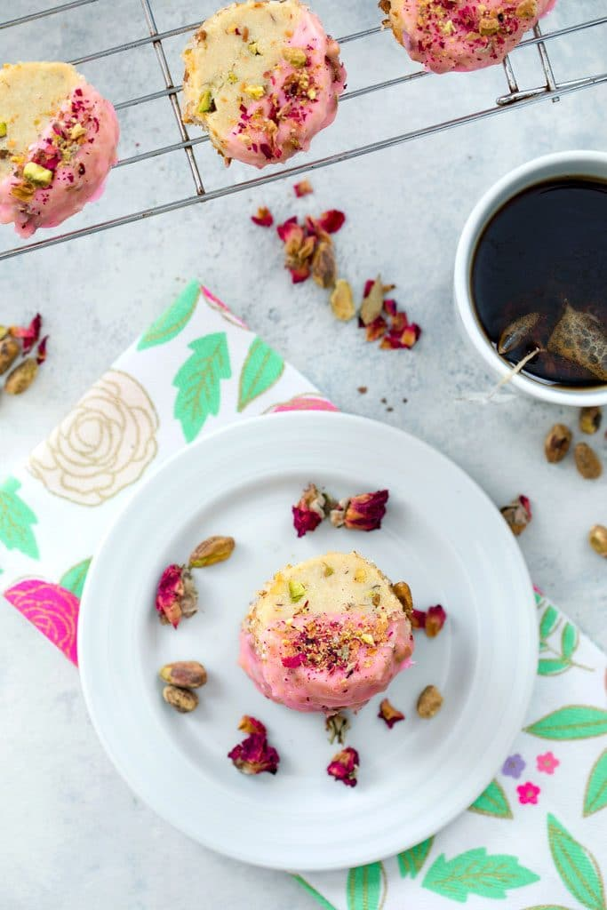 Rose Pistachio Shortbread Cookies -- These cookies take the best ever shortbread cookie recipe and add a fresh twist with crushed pistachio nuts and a pink rose petal icing | wearenotmartha.com