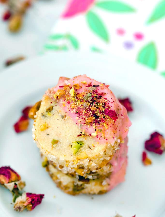 Rose Pistachio Shortbread Cookies -- These cookies take the best ever shortbread cookie recipe and add a fresh twist with crushed pistachio nuts and a pink rose petal icing   wearenotmartha.com