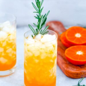 Rosemary Tangerine Cooler -- Caramelized citrus and herbs mix together for this delightful rum-based Tangerine and Rosemary Cocktail   wearenotmartha.com