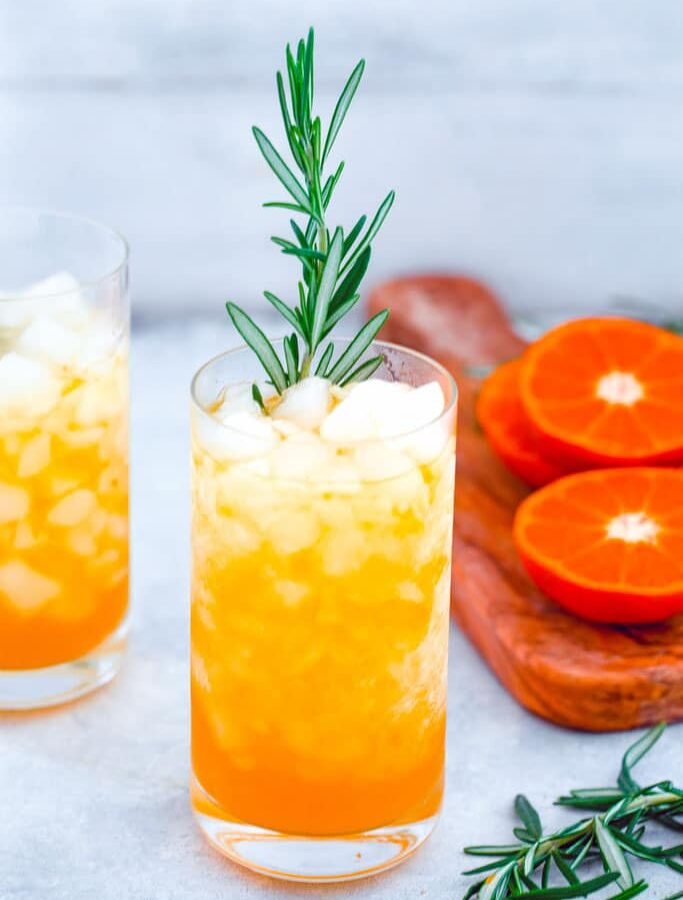Rosemary Tangerine Cooler -- Caramelized citrus and herbs mix together for this delightful rum-based Tangerine and Rosemary Cocktail | wearenotmartha.com