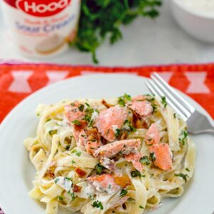 Salmon Fettuccine with Sour Cream Caesar Sauce – This deliciously creamy salmon pasta dish is packed full of flavor thanks to a caesar sauce made with Hood Sour Cream, lots of fresh herbs, and bacon. It's incredibly easy to make and will be on your table in no time! | wearenotmartha.com