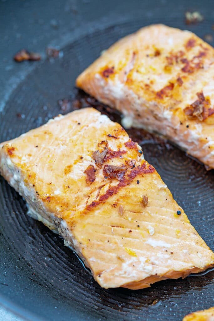 Salmon grilling in pan