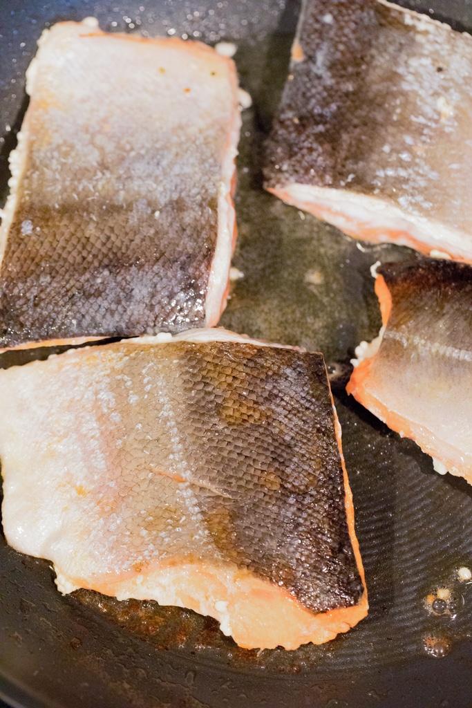 Salmon skin-side-up in skillet