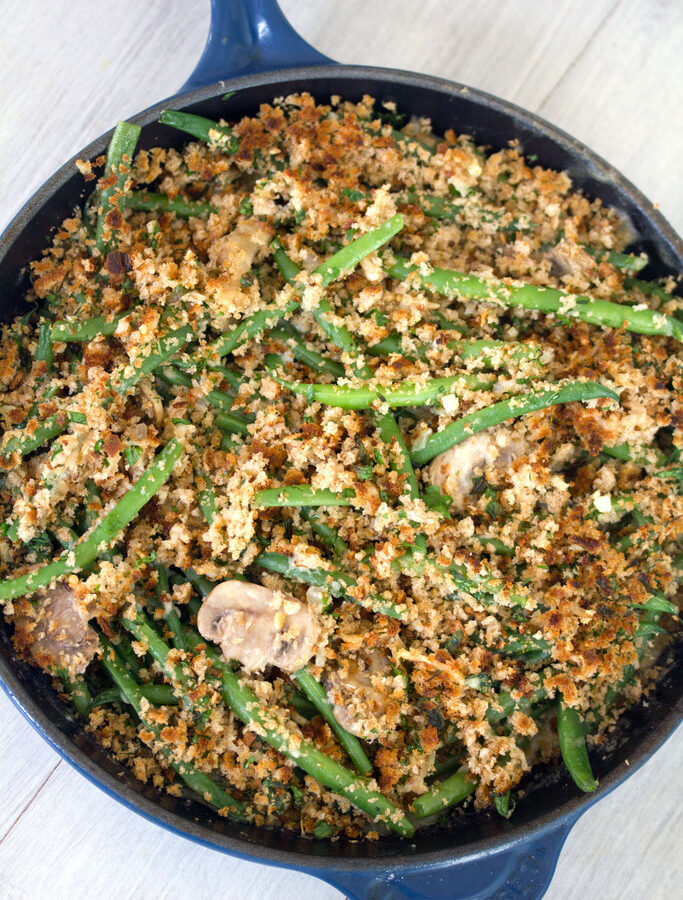 Green Bean Casserole -- Instead of using canned ingredients, try this skillet green bean casserole with fresh green beans and onions, a homemade cream of mushroom sauce, and a crunchy breadcrumb topping | wearenotmartha.com
