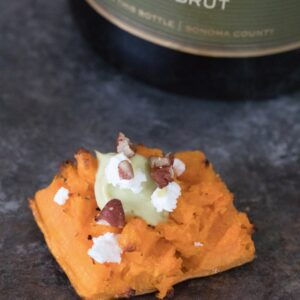 Smashed Sweet Potatoes -- The perfect fall appetizer or side dish, topped with Maple Avocado Crema, goat cheese, and pecans | wearenotmartha.com