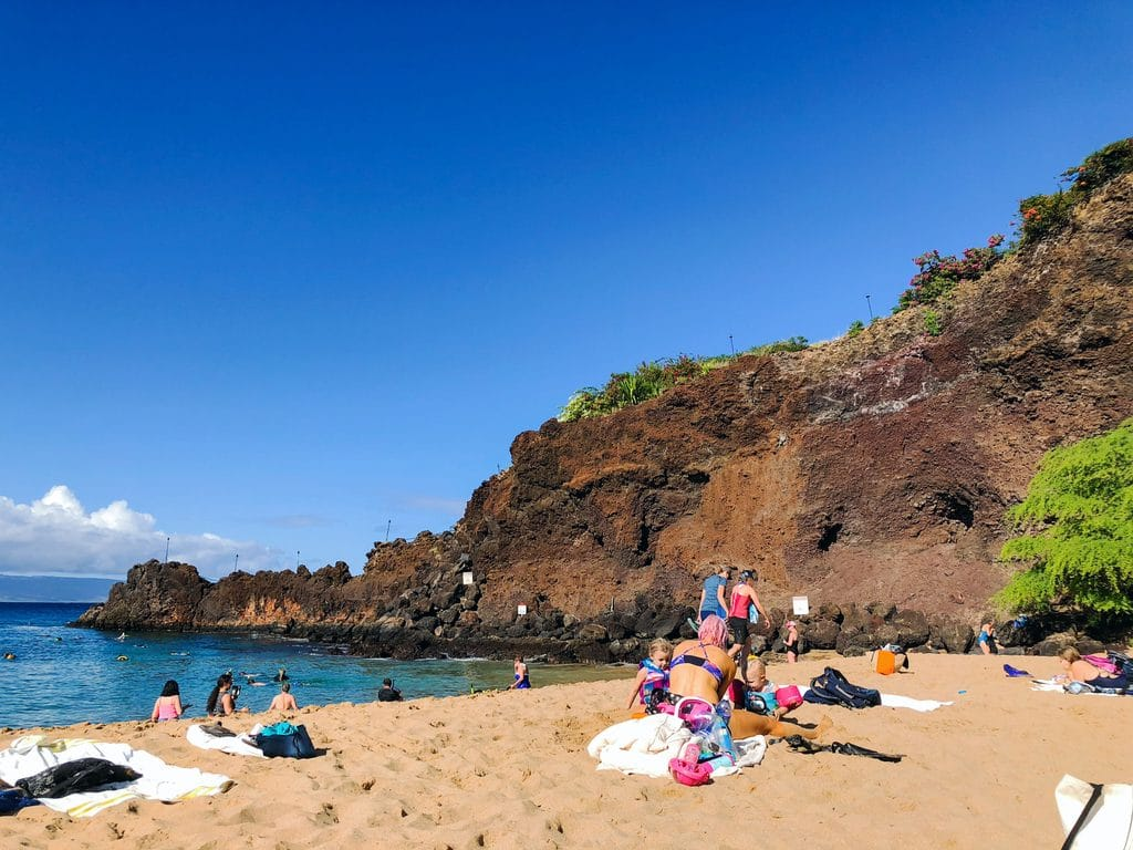 A view of Black Rock on Kaanapali Beach where people are snorkling