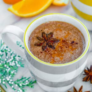 Spiced Hot Buttered Rum -- This Spiced Hot Buttered Rum combines a winter spice-packed brown sugar butter with rum and orange juice for the ultimate winter warmer cocktail | wearenotmartha.com