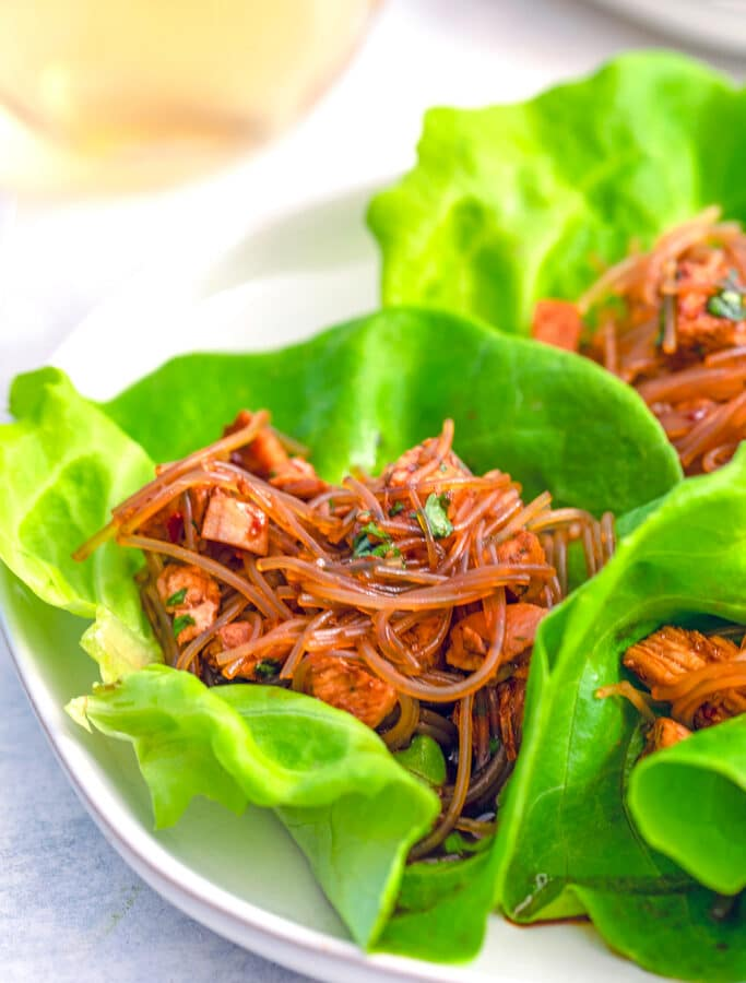 These Spicy Asian Lettuce Wraps are made with chicken, noodles, and a deliciously spicy sauce and are packed with flavor. They make for an easy weeknight dinner!
