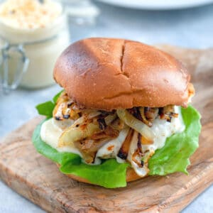 Spicy Cheesy Chicken Burgers -- Chicken burgers don't have to be boring! This Spicy Cheesy Chicken Burger is packed with a flavorful kick, covered in a delicious cheese sauce, and served on a toasted brioche bun | wearenotmartha.com
