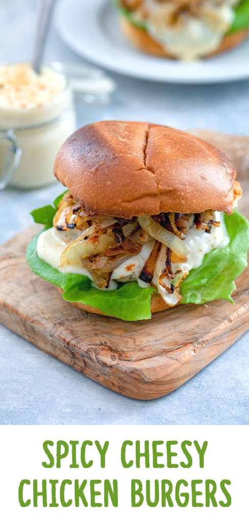 Spicy Cheesy Chicken Burgers -- Chicken burgers don't have to be boring! This Spicy Cheesy Chicken Burger is packed with a flavorful kick, covered in a delicious cheese sauce, and served on a toasted brioche bun | wearenotmartha.com #chicken #burgers #spicy #cheese