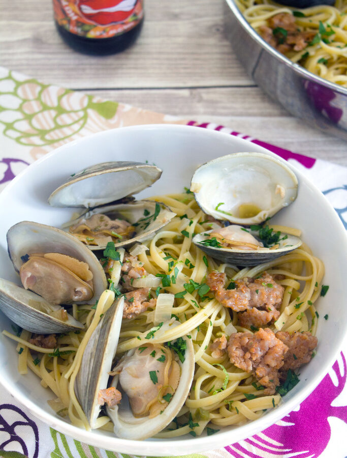 Spicy Lime Linguine with Clams and Sausage -- Linguine with Clams and a spicy twist... The secret ingredients in this meal favorite are spicy sausage, lime juice, and a hot pepper hard cider | wearenotmartha.com