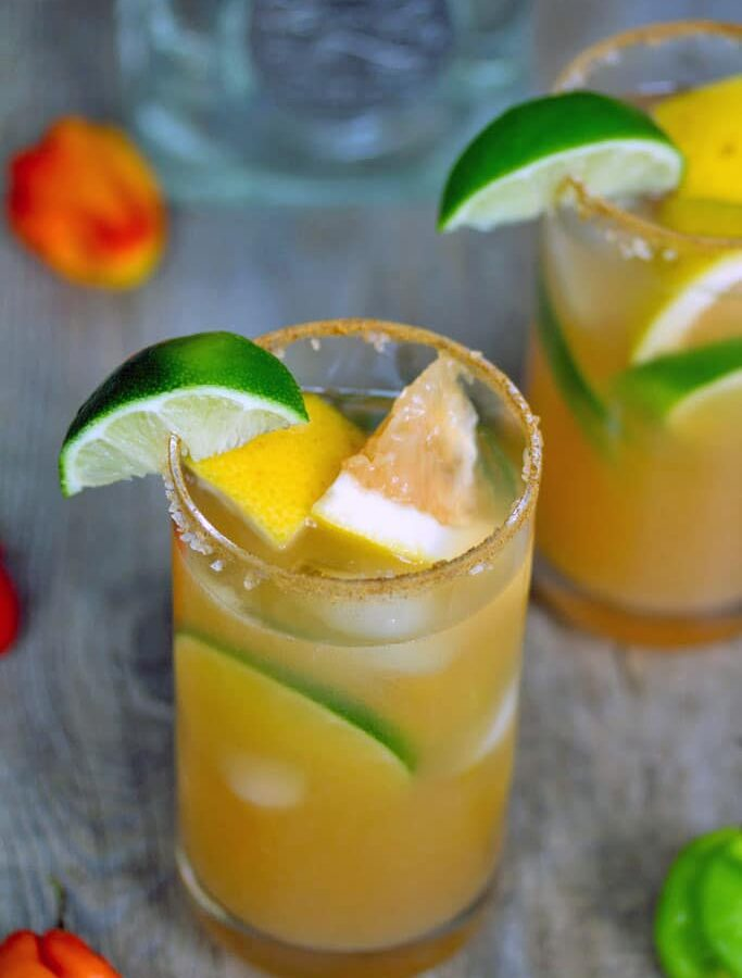 Spicy Roasted Grapefruit Margarita -- This Spicy Roasted Grapefruit Margarita consists of grapefruit that's been broiled and tequila that's been infused with habanero and is the most delicious margarita you'll ever try | wearenotmartha.com