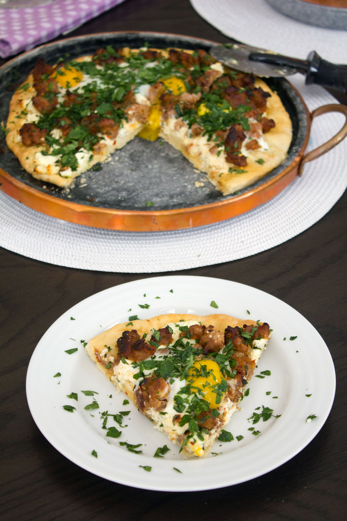 Spicy Sausage Pizza with Feta and Parsley -- And don't forget the eggs ...