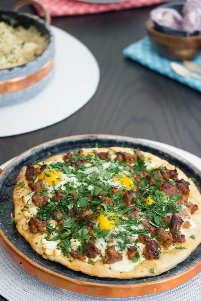 Spicy Sausage Pizza with Feta and Parsley -- And don't forget the eggs on top! | wearenotmartha.com