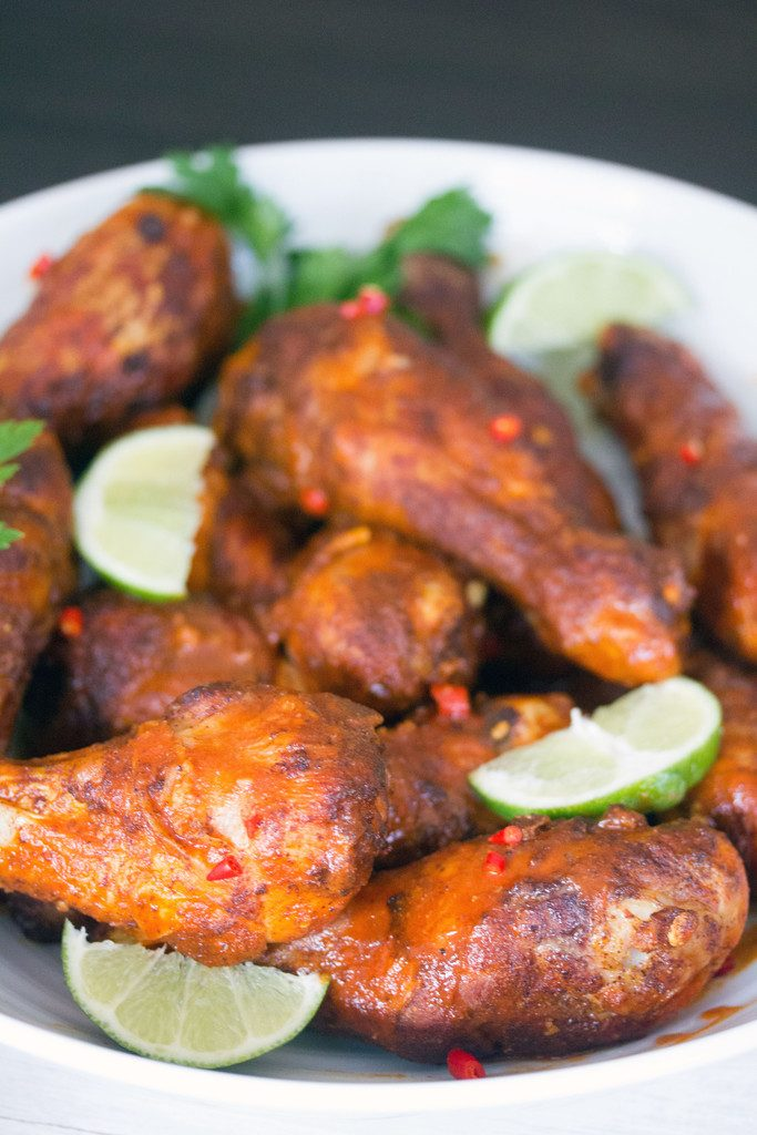 Spicy Thai Chicken Drumsticks -- Sriracha, Thai chiles, and lime give ...