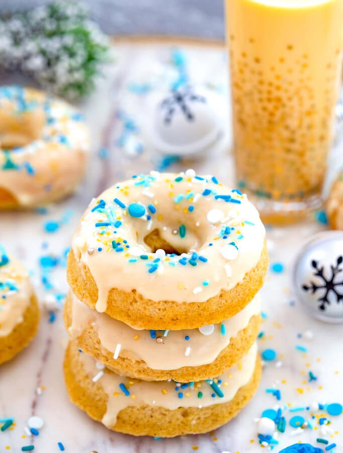Spiked Eggnog Doughnuts -- These Spiked Eggnog Doughnuts are packed with festive eggnog flavor and just a touch of rum (you can leave out the rum if you want!). They're incredibly moist baked doughnuts perfect for celebrating the holiday season! | wearenotmartha.com