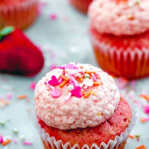 Sprinkles Strawberry Cupcakes -- These strawberry cupcakes are based off the Sprinkles Strawberry Cupcakes recipe and with fresh strawberries in both the cake and the frosting, they're packed with fruity flavor | wearenotmartha.com