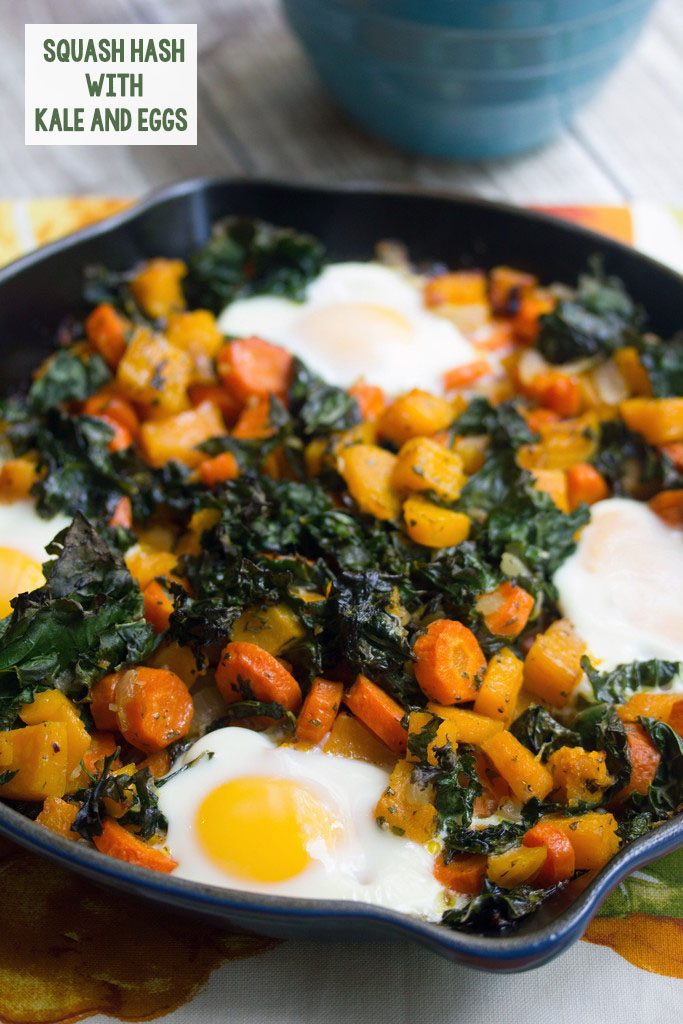 Head-on view of a cast iron skillet with squash hash with kale and eggs with recipe title at top