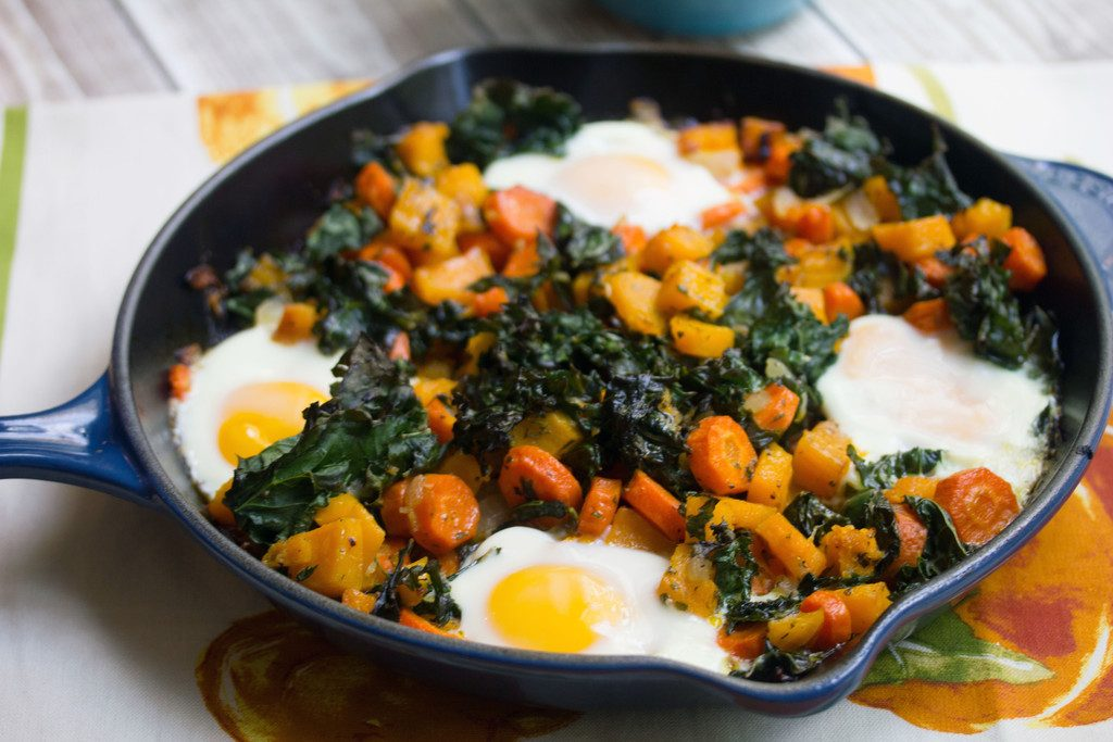 Landscape head-on closeup view of squash hash with kale and eggs