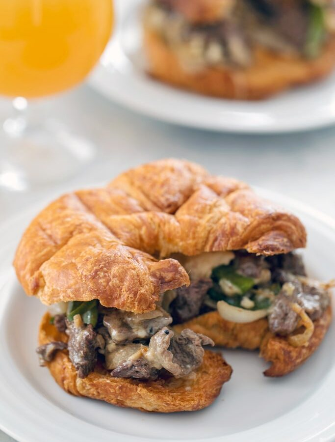 Steak and Cheese Croissants -- There are a few important components necessary for the perfect steak and cheese sandwich. These hit all the marks and make for the ultimate lunch or dinner | wearenotmartha.com