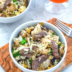 Steak and Cheese Fried Rice -- This Steak and Cheese Fried Rice is a 30-minute meal perfect for serving on a busy weeknight. Made with ribeye, peppers, onions, and mushrooms, the dish is packed with flavor and is the ultimate anytime comfort food | wearenotmartha.com