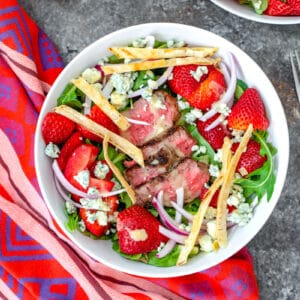 Packed with deliciously satisfying ingredients, this Steak and Strawberry Salad is the ultimate summer salad and requires minimal time standing over a hot stove or grill.