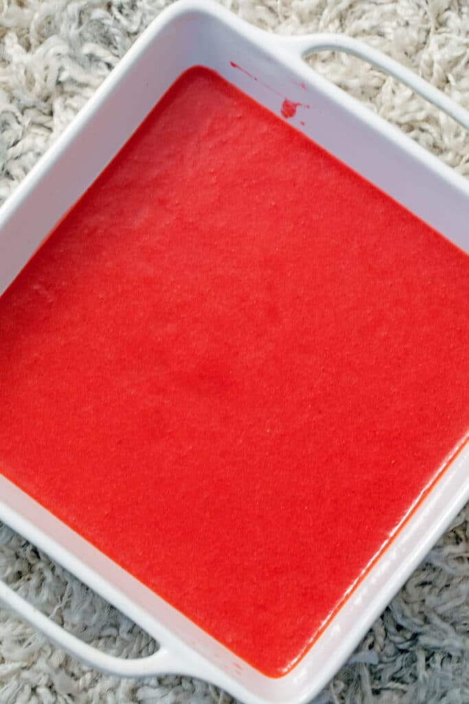 Overhead view of strawberry puree in square dish