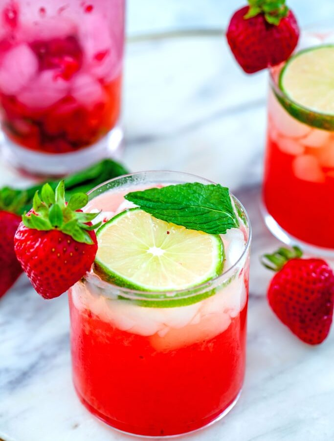 Strawberry Mojitos -- These Strawberry Mojitos are made with fresh strawberries, mint, rum, simple syrup, and lime juice and are the only cocktail you'll need this summer | wearenotmartha.com