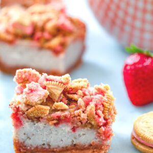 Strawberry Shortcake Cheesecake Bars -- These Strawberry Shortcake Cheesecake Bars are a delicious summer dessert perfect for BBQs or summer parties. They're packed with fresh strawberries and have a Strawberry Shortcake Oreo crust and crumble on top | wearenotmartha.com