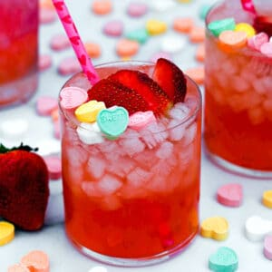 Looking for a love potion this Valentine's Day? Just add strawberry vanilla simple syrup, vodka, and lime juice for this Strawberry Vanilla Love Potion Cocktail! Top it with conversation hearts for February 14 or enjoy it with a loved one any day of the year.