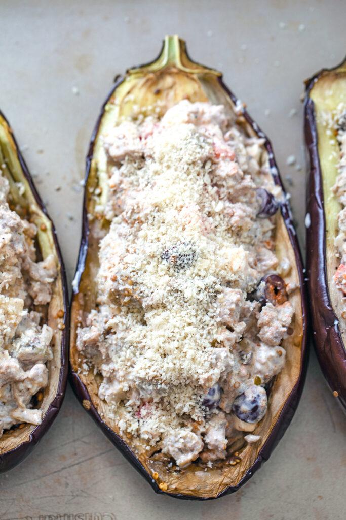 Overhead view of eggplant halves stuffed with Mediterranean turkey mixture