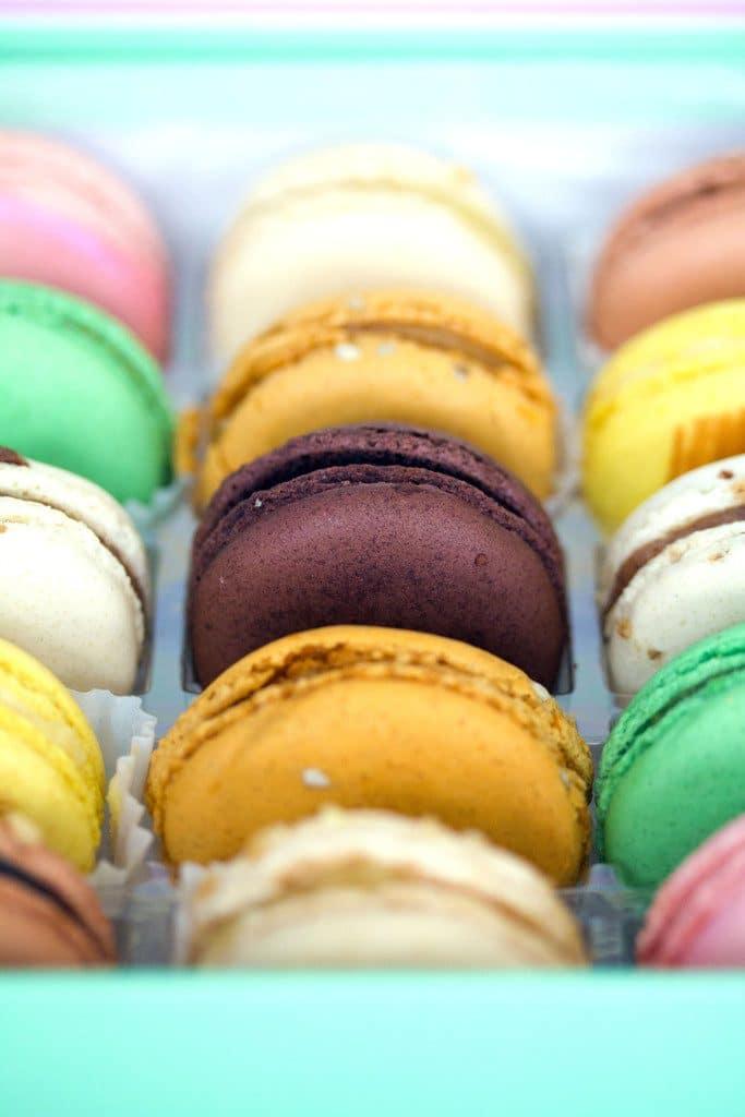 Closeup of various colorful macarons from Sucré
