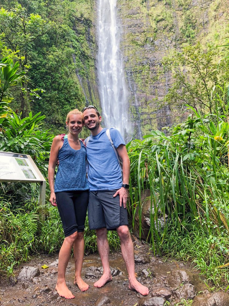 Sues and Chris standing in front of Waimoku Falls on Pipiwai Trail