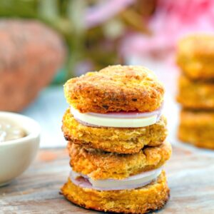 Sweet Potato Biscuit Ham Sandwiches -- You can certainly eat these sweet potato biscuits with just a little bit of butter, but I prefer them turned into sweet potato ham sandwiches with Swiss cheese, dijon mustard, and a honey drizzle | wearenomartha.com #sweetpotatoes #biscuits #hamsandwiches