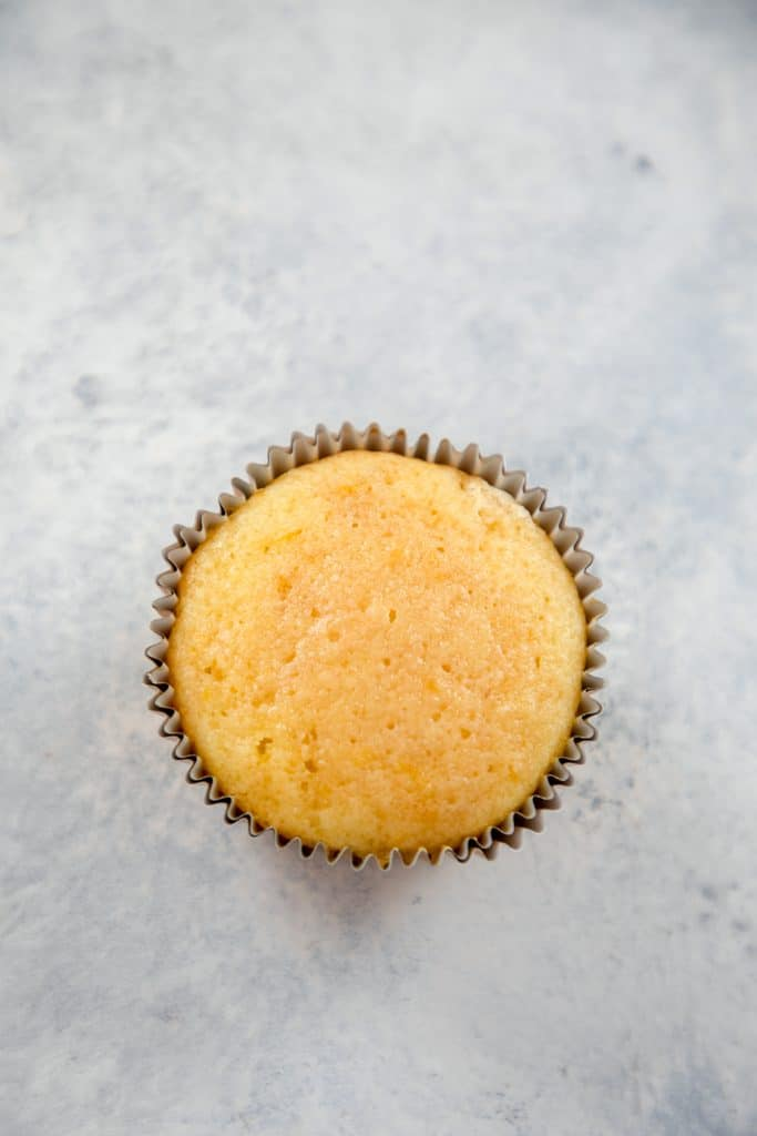 Single sweet tea vodka cupcake just out of the oven and cooled with sweet tea vodka brushed on