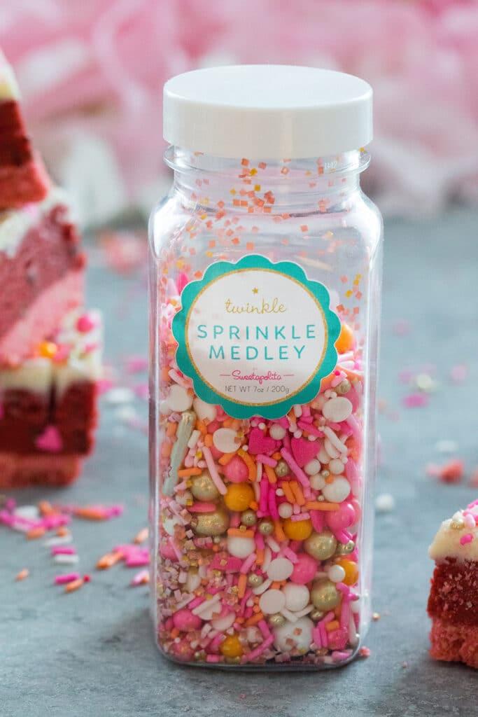 Sweetapolita Twinkle Sprinkle Medley with pink, orange, white, and gold sprinkles