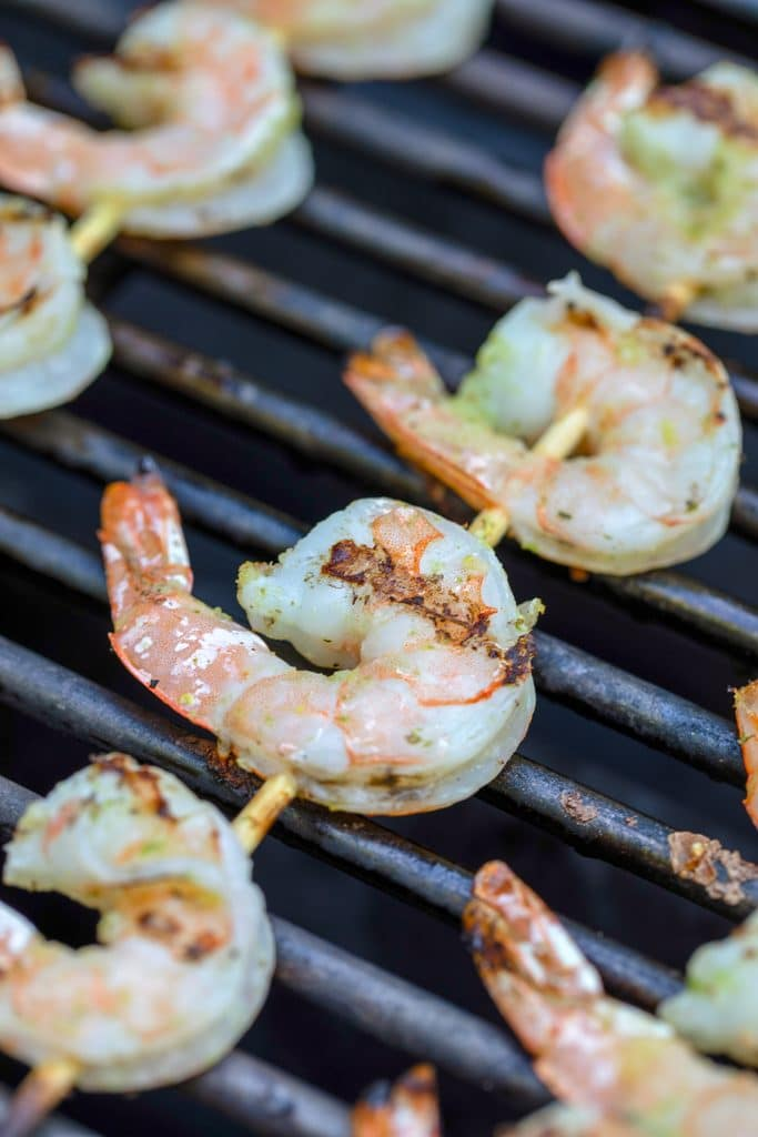 Shrimp skewers on grill turning pink
